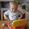 baby on toy laptop