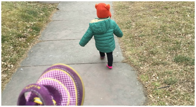 Toddler gives up on putting her shoe on