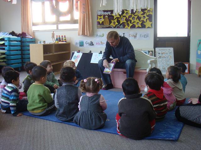 reading aloud to class - man